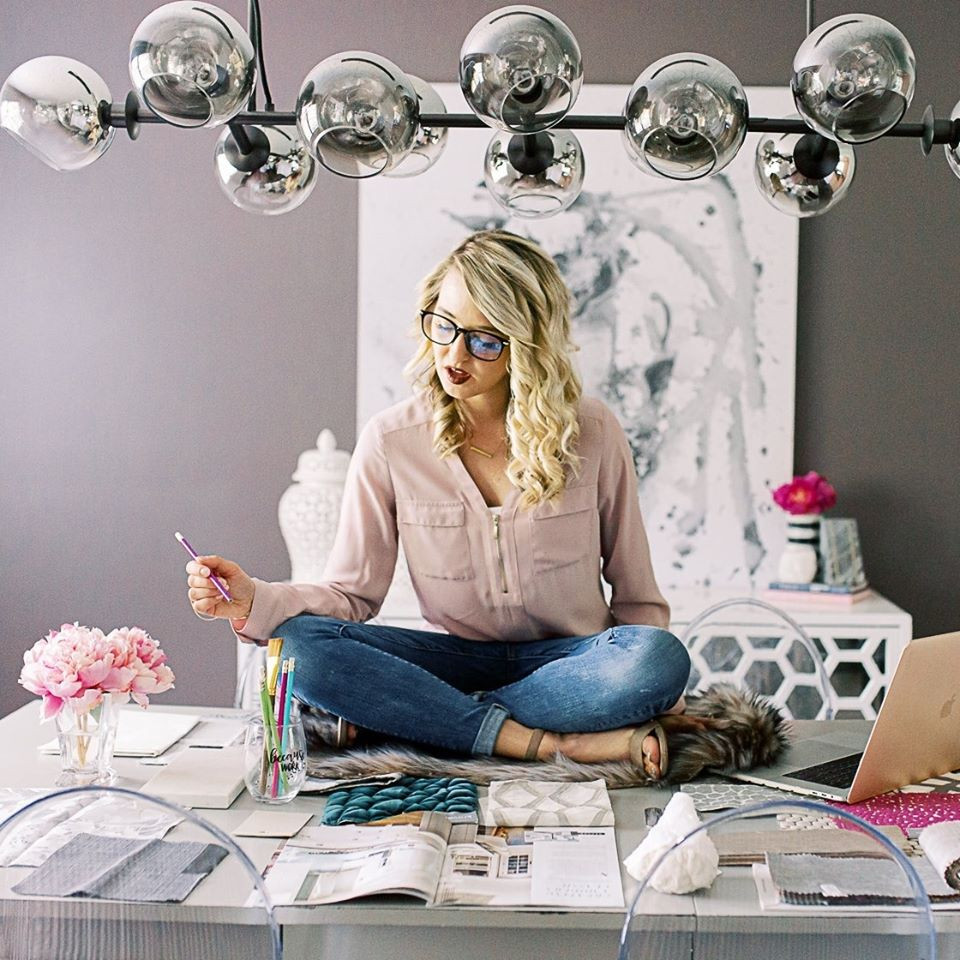 interior designer sitting on a table working